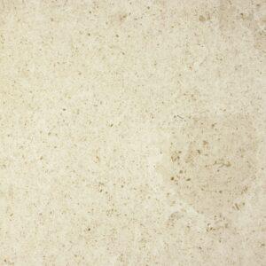 A pedra NFT MS é um calcário de cor bege, com um aspecto compacto. É um calcário de alguma dureza, de grão médio e com algumas sombras. Apresenta pequenos fósseis dispersos.